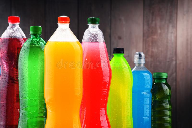 Plastic bottles of assorted carbonated soft drinks. In variety of colors stock photos