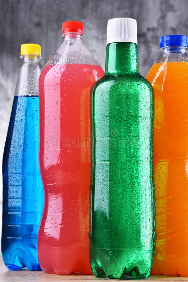 Plastic bottles of assorted carbonated soft drinks. In variety of colors royalty free stock image