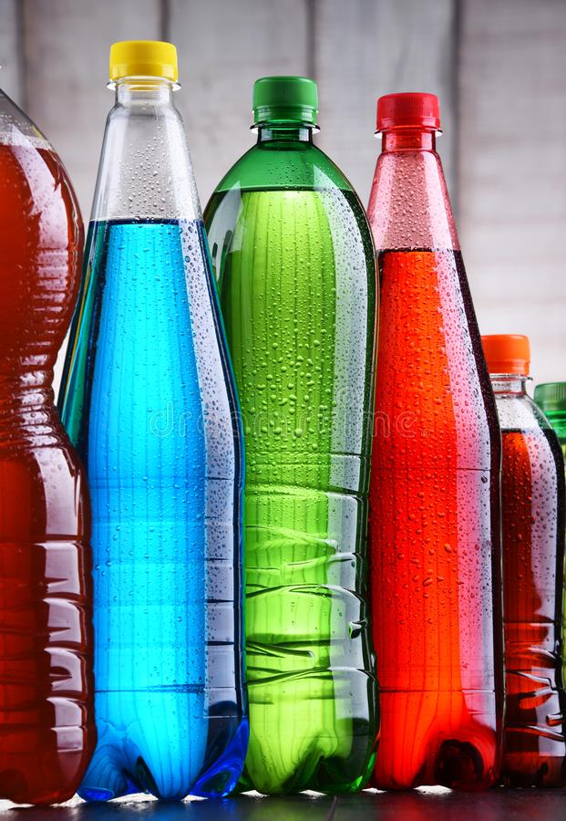 Plastic bottles of assorted carbonated soft drinks. In variety of colors stock images