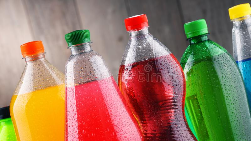 Plastic bottles of assorted carbonated soft drinks. In variety of colors stock image