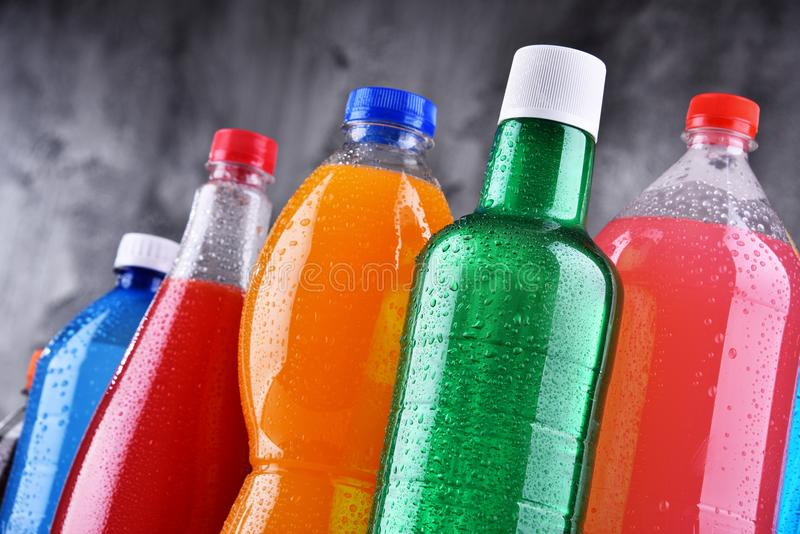 Plastic bottles of assorted carbonated soft drinks. In variety of colors royalty free stock photography