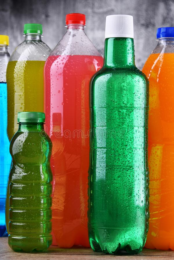 Plastic bottles of assorted carbonated soft drinks. In variety of colors stock photography