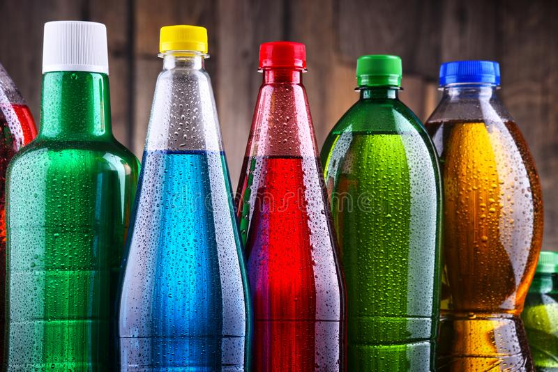 Plastic bottles of assorted carbonated soft drinks. In variety of colors royalty free stock images