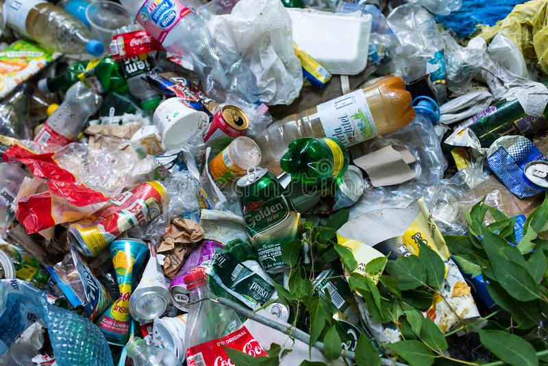 Plastic bottles , beer cans , human trash near roadside, conceptual image of human negligence. stock photos