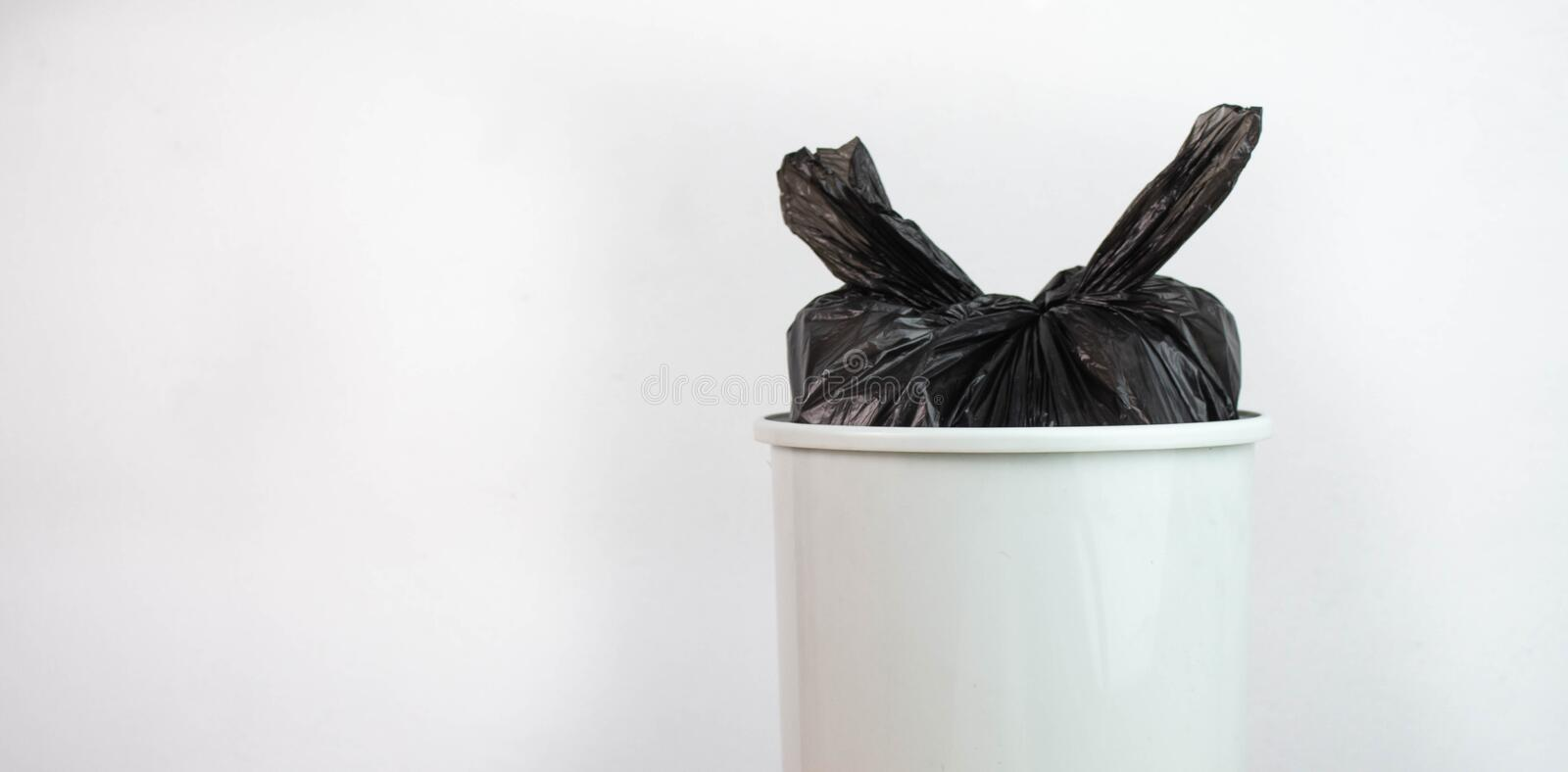 .Plastic bottles in black garbage bags that binds in trash waiting to be taken to recycle. Concept save the earth royalty free stock image