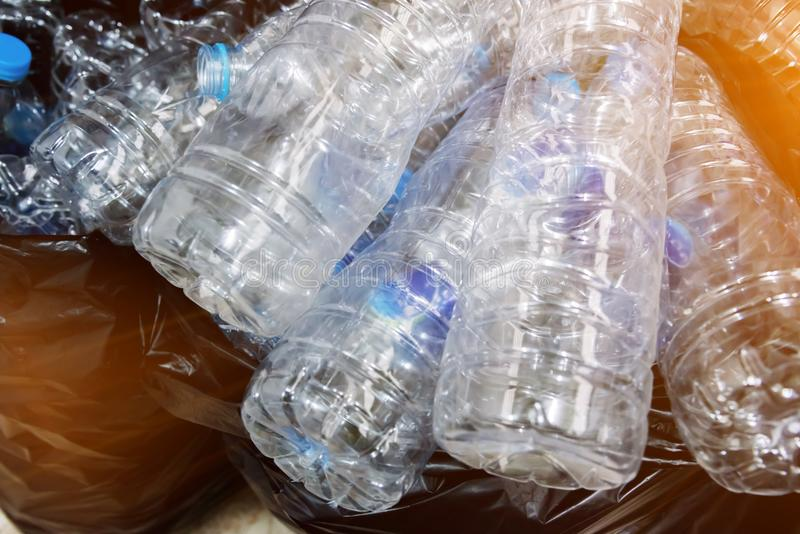 Plastic bottles in black garbage bags waiting to be taken to recycle. stock photography