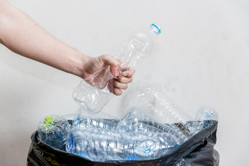 Plastic bottles in black garbage bags waiting to be taken to recycle royalty free stock photography