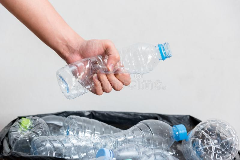 Plastic bottles in black garbage bags waiting to be taken to recycle royalty free stock photo