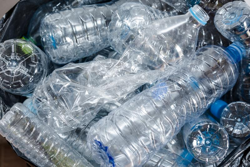 Plastic bottles in black garbage bags waiting to be taken to recycle royalty free stock image