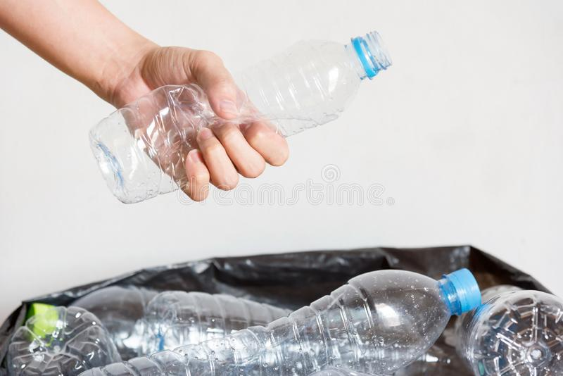 Plastic bottles in black garbage bags waiting to be taken to recycle stock image