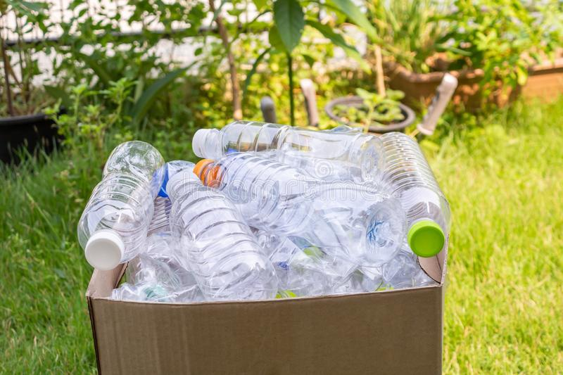 Plastic bottles in brown recycle garbage box royalty free stock photography