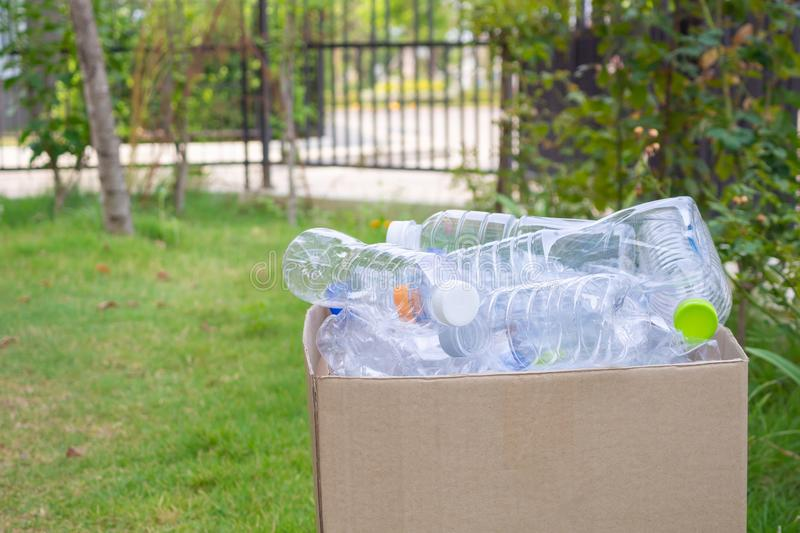 Plastic bottles in brown recycle garbage box stock image
