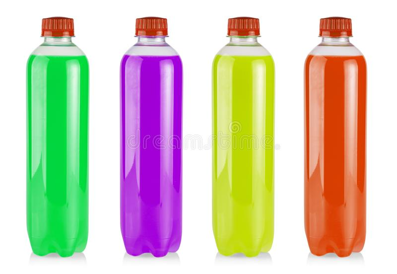 The plastic bottles with colored juice on white royalty free stock photos