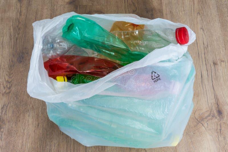 Plastic bottles. Ecological separation of household waste. Crumpled pet bottles in a carrier bag stock image