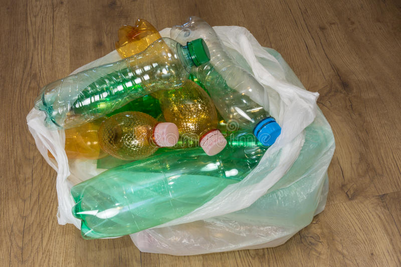 Plastic bottles. Ecological separation of household waste. Empty pet bottles in a plastic bag royalty free stock photos