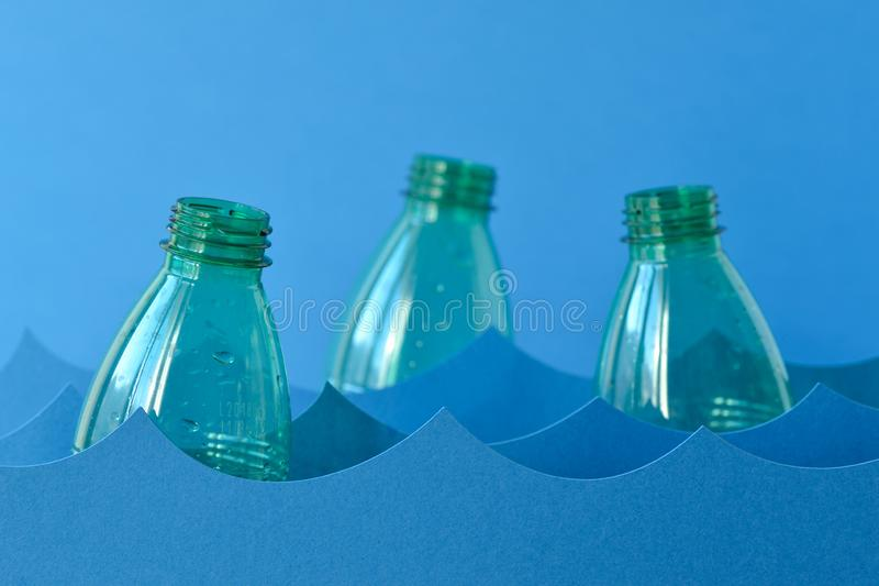 Plastic bottles floating on water - Sea pollution concept stock images