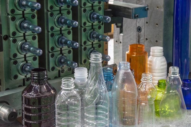 The plastic bottles and injection mold in background. stock photo