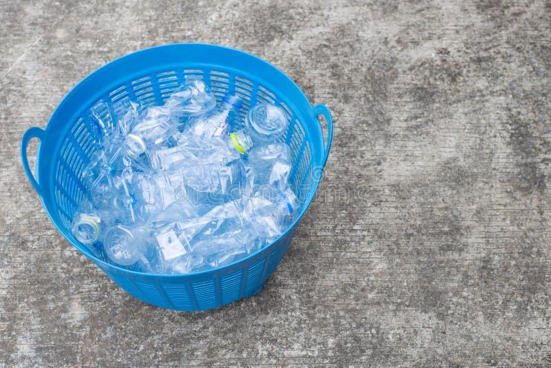 Plastic bottles in waste basket royalty free stock photo