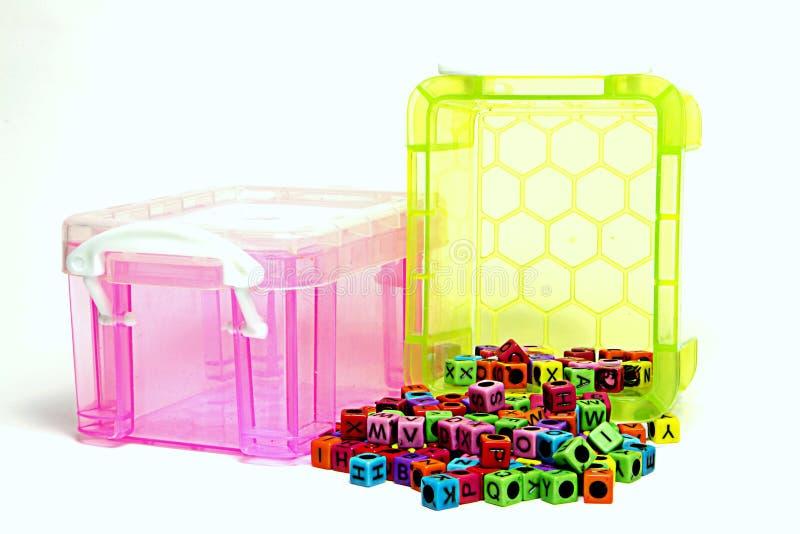 Plastic box. With alphabet beads inside stock image