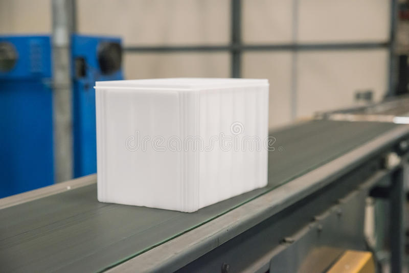 Plastic box in belt in factory.  royalty free stock image