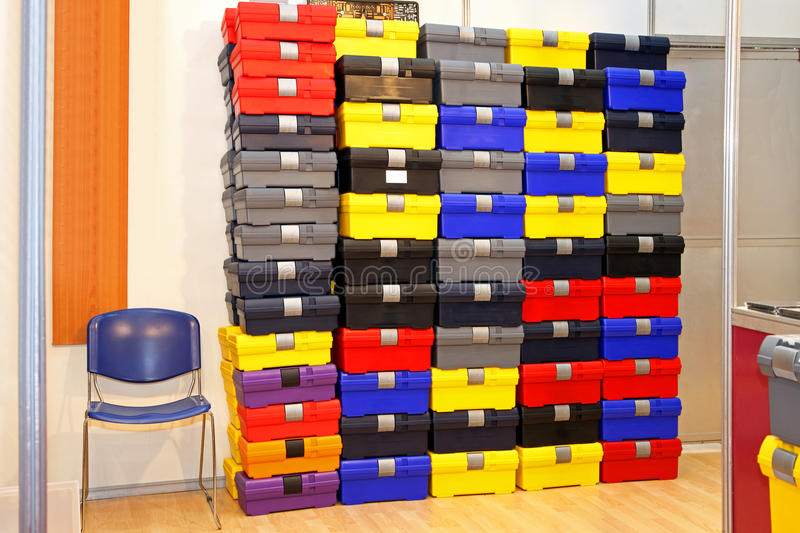 Plastic boxes. Large pile of colorful plastic tool boxes in office storage space royalty free stock photos