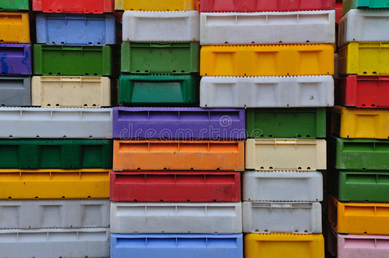 Plastic boxes. Quite a lot of stacked colorful plastic boxes royalty free stock images