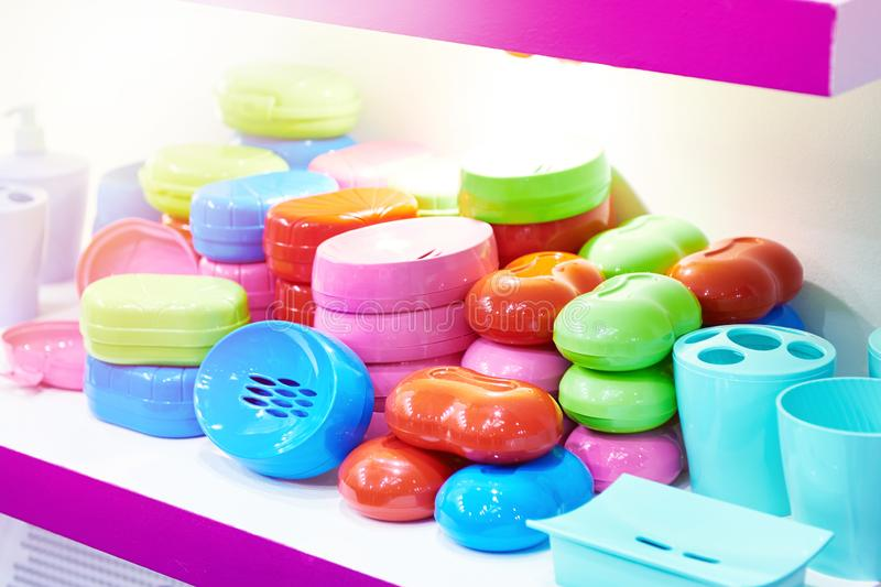 Plastic boxes for soap in store stock images