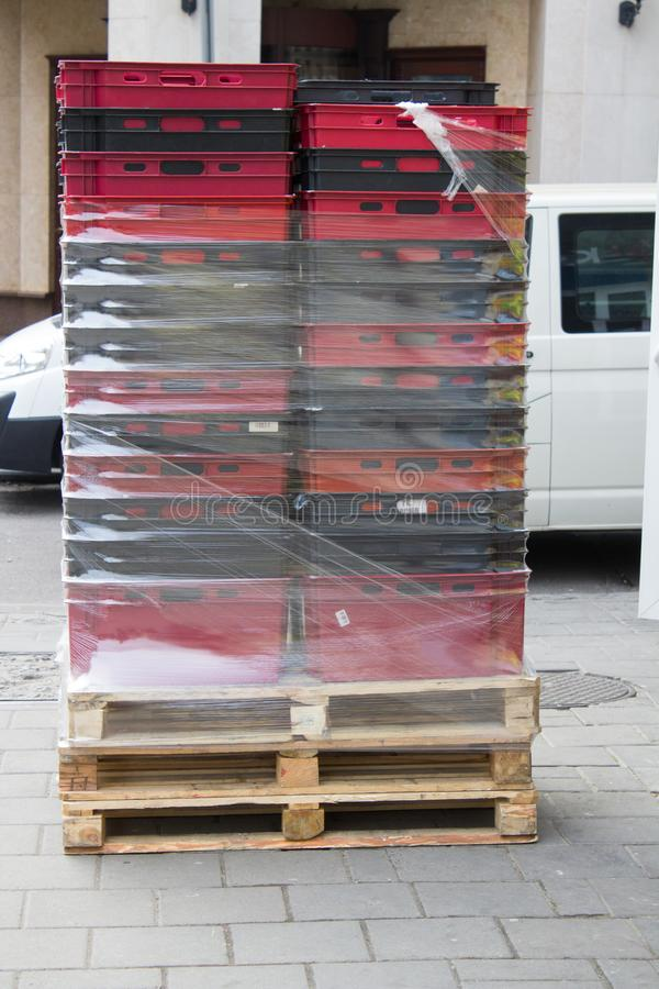 Plastic boxes on the street. Delivery of goods to a store in plastic boxes stock image