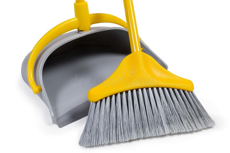 Plastic broom for sweeping floors and dustpan, fragment close-up royalty free stock photo