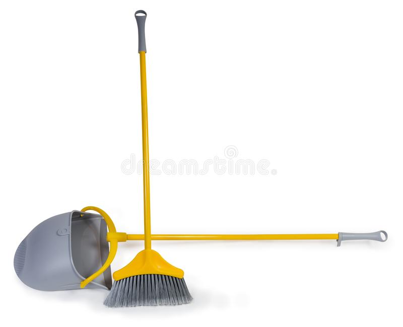 Plastic broom for sweeping floors and dustpan with long handles. Kit of the yellow plastic broom with gray bristles for sweeping floors and long-handled dustpan royalty free stock image