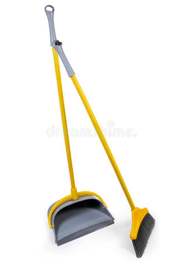 Plastic broom for sweeping floors with dustpan on white background. Kit of the yellow plastic broom with gray bristles for sweeping floors and long-handled royalty free stock photo