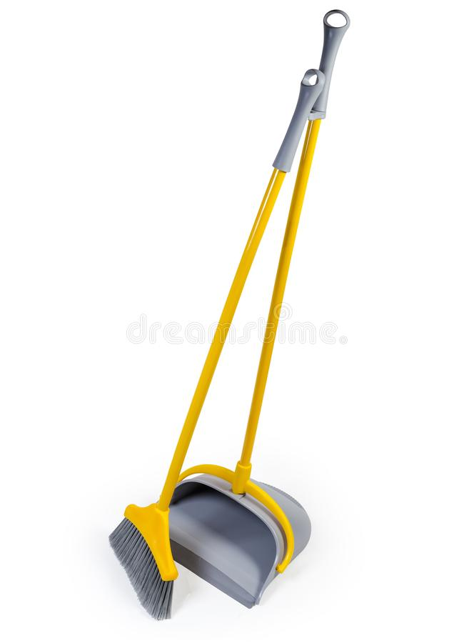 Plastic broom for sweeping floors with dustpan on white background. Kit of the yellow plastic broom with gray bristles for sweeping floors and long-handled royalty free stock images