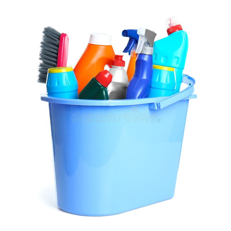 Plastic bucket with different cleaning products on white stock photos