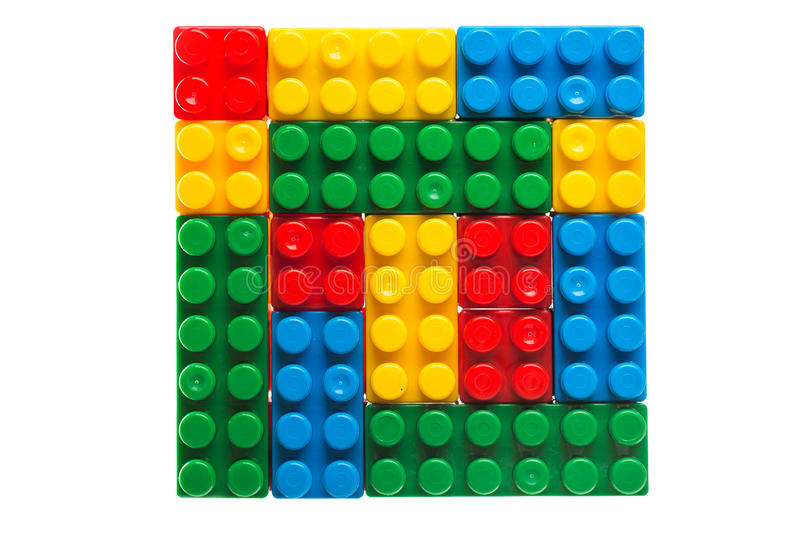Plastic building blocks or lego cubes isolated on white stock photos