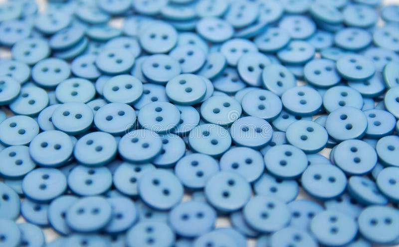 Plastic plastic buttons pellets scattered on a white background stock images
