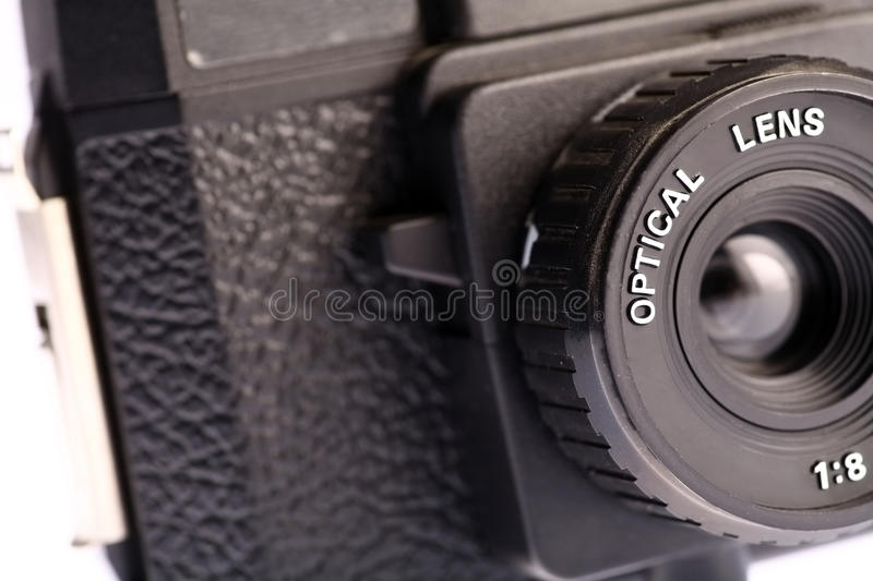 Plastic camera. An old film plastic camera isolated on white royalty free stock photos