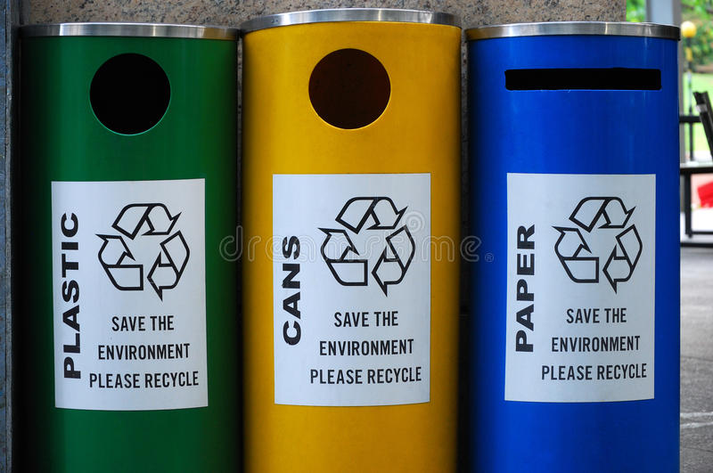 Plastic, cans and paper recycling bins. A photo taken on plastic, cans and papers recycling bins with the recycle logo stock photography