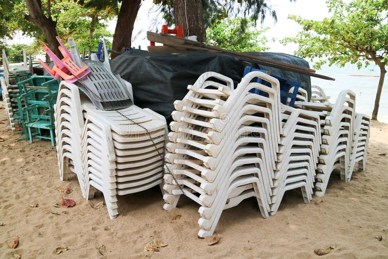 plastic chair and table and umbrella had pack of group when forcast of storm prediction stock photo