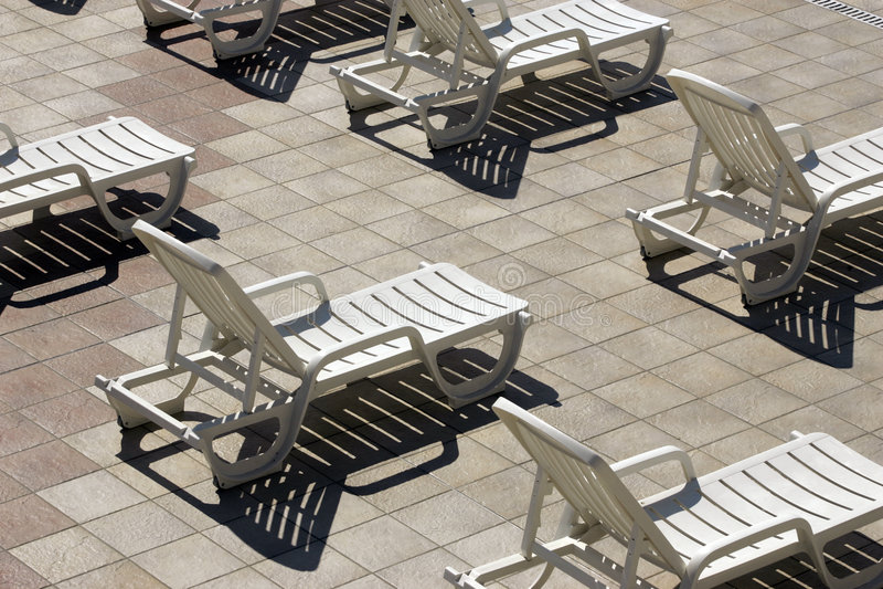 Plastic chaise stock photos