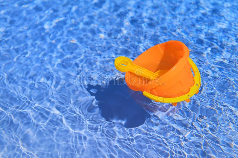 Floating toys in the swimming pool. Plastic child toys floating in the swimming pool outdoor stock photography