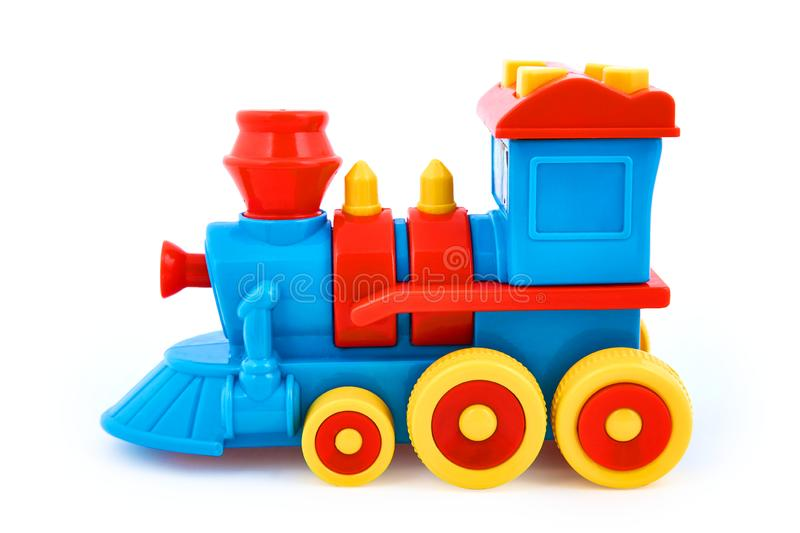 Plastic children`s toy locomotive isolated on white background royalty free stock photo