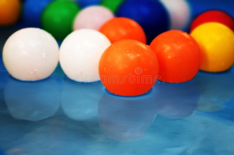 Plastic colored balls in the children`s pool royalty free stock images