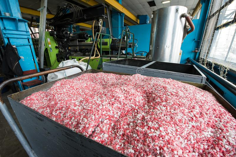 Plastic colored granulated crumb at the plant for processing and royalty free stock photography