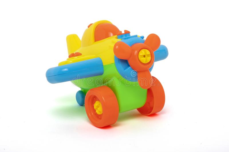 Plastic toys for baby. Plastic colors toys, little plane for baby on white background stock photos