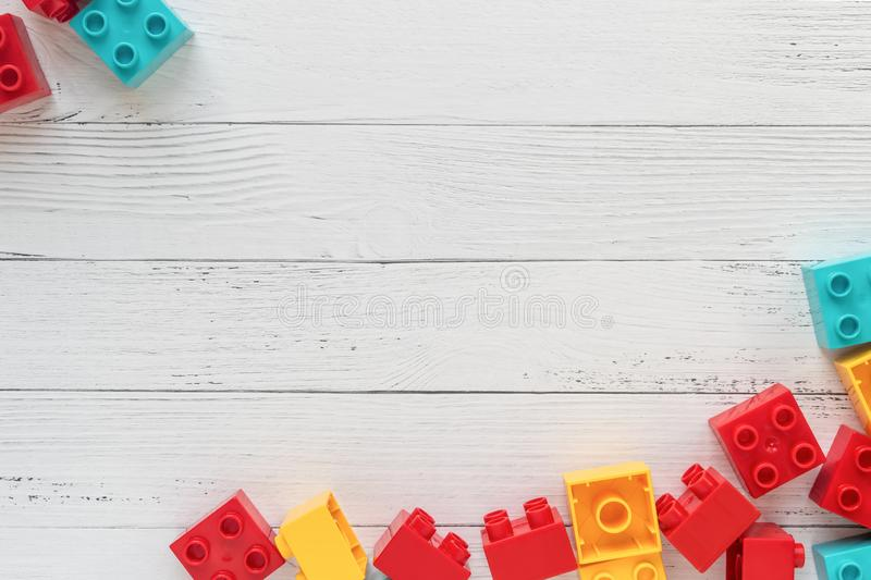 Lego Plastic constructor bricks on white wooden background. Popular toys. Free space for text. Lego Multicolored Plastic constructor bricks on white wooden royalty free stock photography