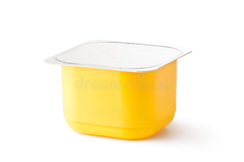 Plastic container for dairy products with foil lid stock image