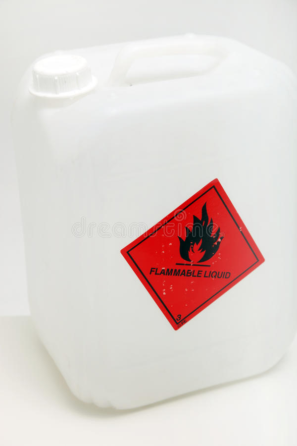 Plastic Container With Flammble Label. White plastic container with a red flammable hazard label on the outside stock photos