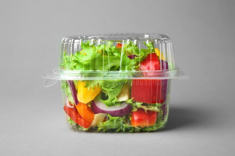 Plastic container with salad royalty free stock photos