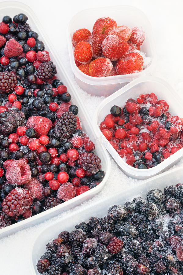 Download Plastic Containers Of Frozen Mixed Berries In Snow Stock Photos - Image: 23379673