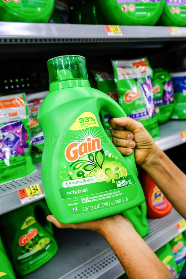 Plastic containers of Gain brand liquid laundry detergent. Plastic containers of Procter and Gamble Gain brand liquid laundry detergent  in a supermarket aisle royalty free stock photography
